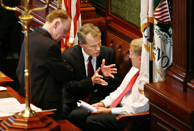 House Speaker Michael Madigan, D-Chicago, talks with House Minority Leader Tom Cross, R-Oswego, as Madigan's Chief of Staff Tim Mapes listens in prior to the House convening at the Illinois Capitol on Monday, Aug. 6, 2007, in Springfield, Ill. (AP Photo/The State Journal-Register, Jonathan Kirshner)