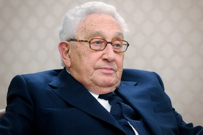 Former U.S. Secretary of State Kissinger looks on during a meeting with Russia's PM Putin in Moscow