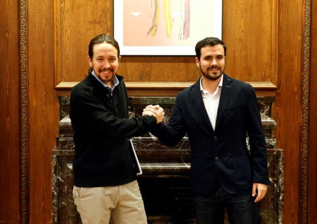 Podemos (We Can) leader Pablo Iglesias and Izquierda Unida (United Left) leader Alberto Garzon pose before their meeting at the Spanish parliament in Madrid