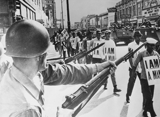Civil Rights U.S.A. pic: 30th March 1968. Memphis, Tennessee. Guardsmen with fixed bayonets in Beale Street, Memphis as black marchers stage a protest march.