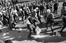U.S. Marshals try to control anti-Vietnam War demonstrators by using force near the Pentagon in Washington, D.C. on Oct. 21, 1967. (AP Photo)