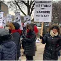 Chicago charter strike settled.